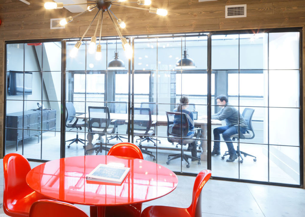 Red waiting table and large conference room with two members
