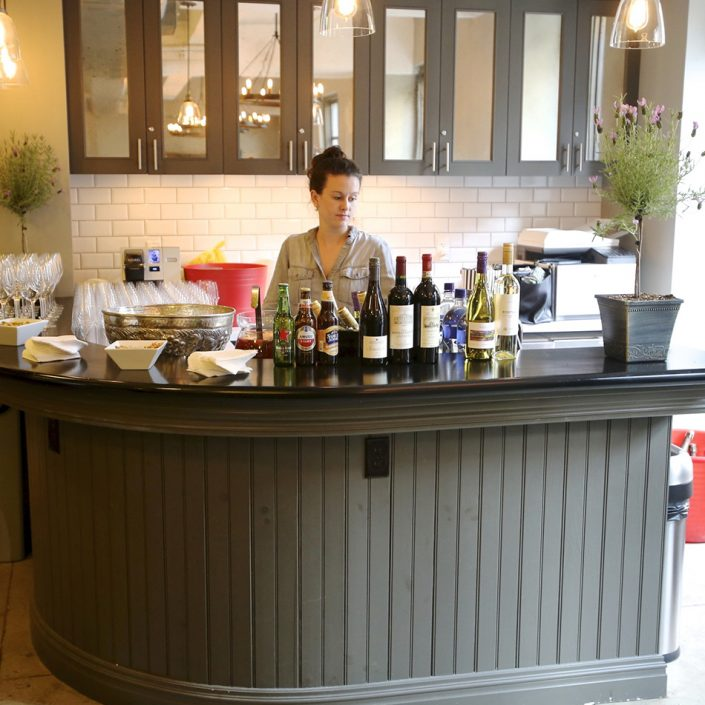 Numerous event spaces of various configurations. Image features a bar with beverages ready to host your next event.
